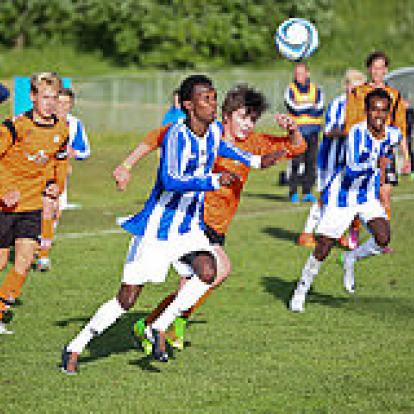 Boys playing football.