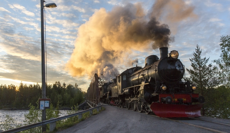 Steam train crossing the Pite River in the glow of the midnight sun